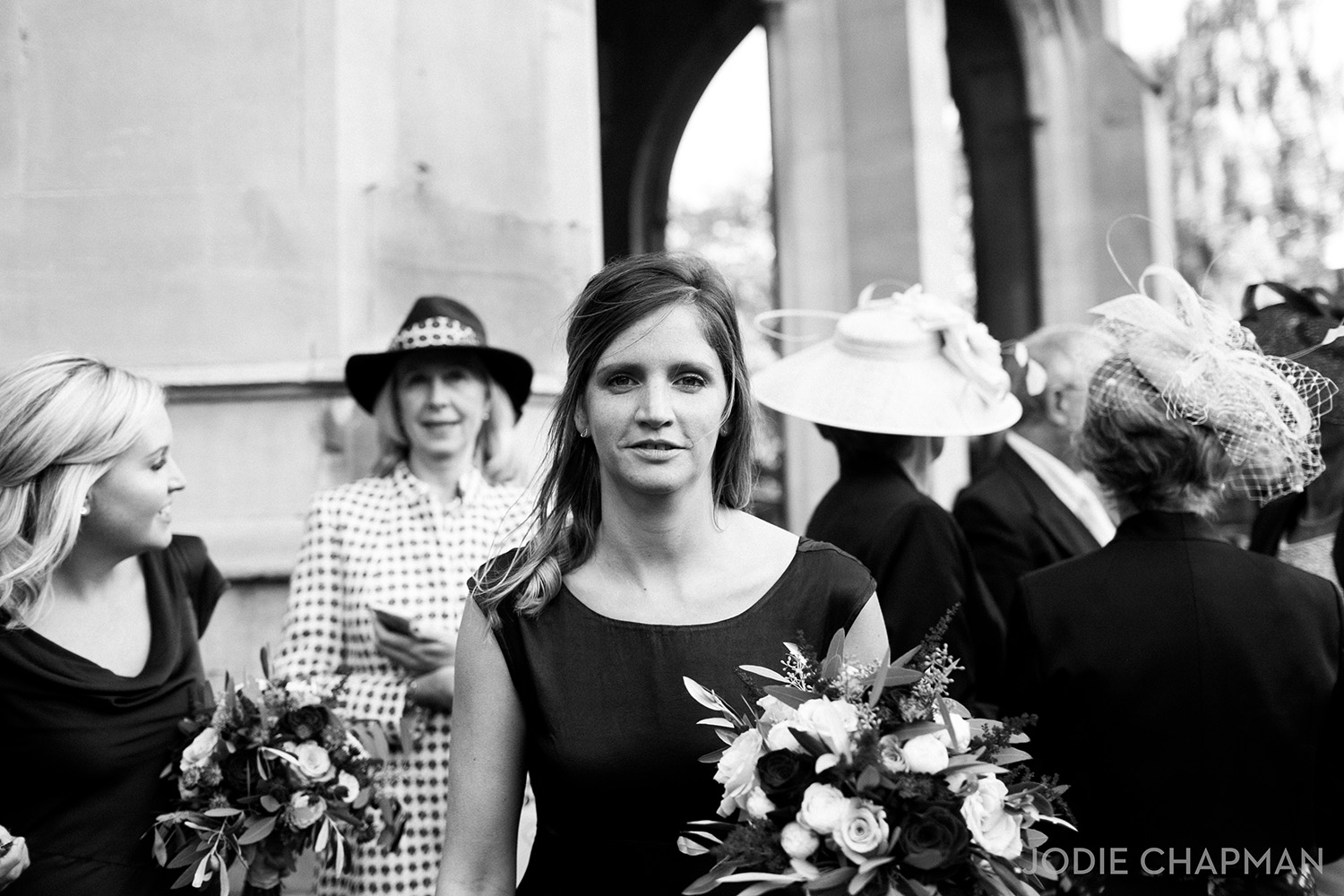 wedding guests outside st lukes church chelsea