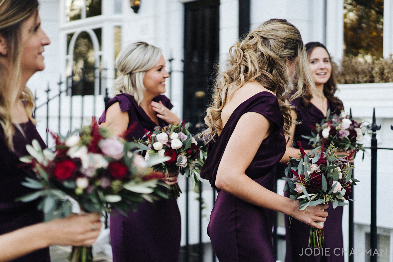 bridesmaids at a winter wedding with festive bouquets